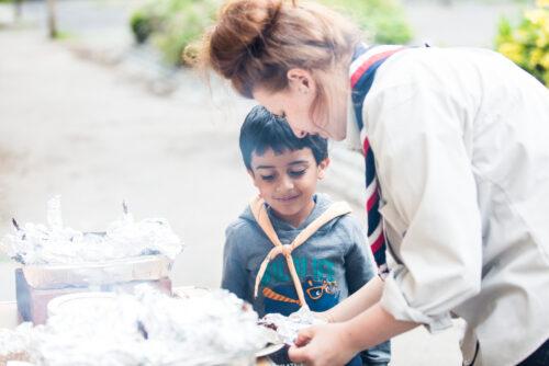 leader helping cub